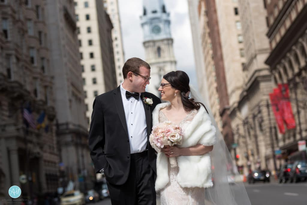 bride and groom on broad street in front of city hall