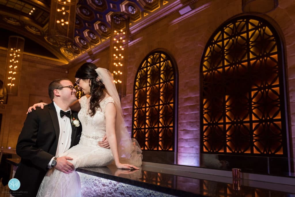 bride and groom on the bar in Union Trust Philadelphia