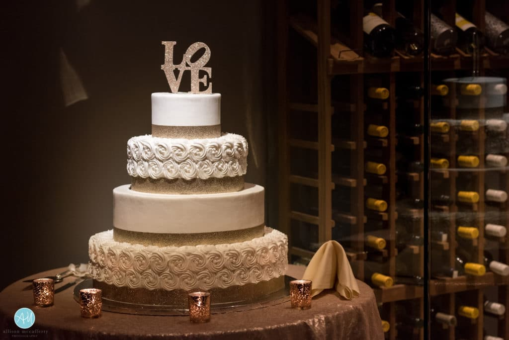 glitter and gold love wedding cake