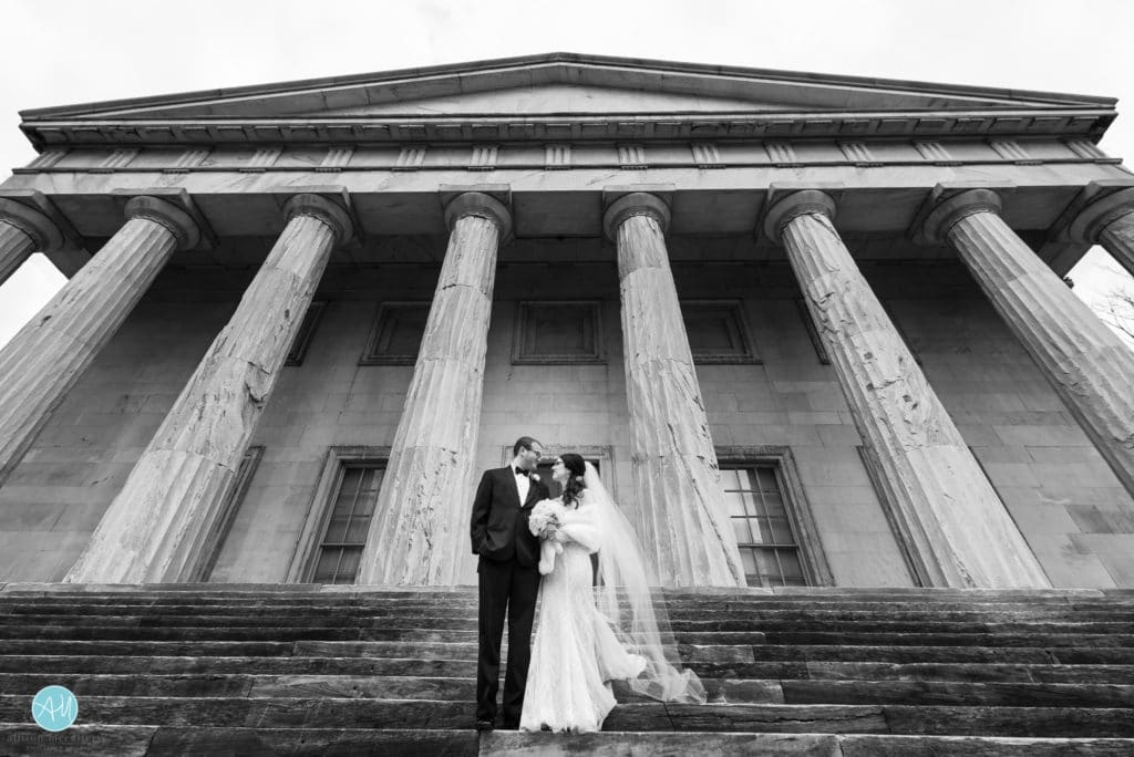 bride and groom on the steps of the second bank of the united states philadelphia