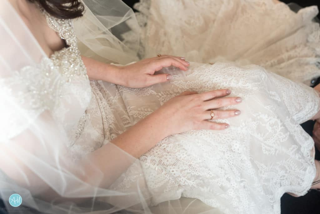 bride's manicure matches her champagne gown