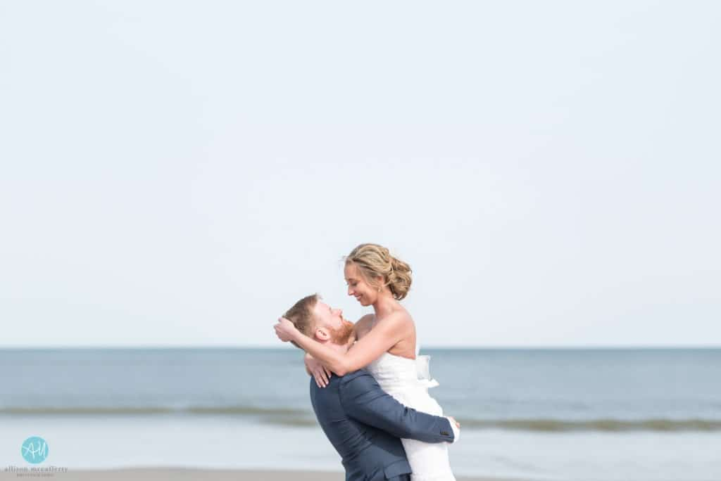 bride and groom on beach after wedding