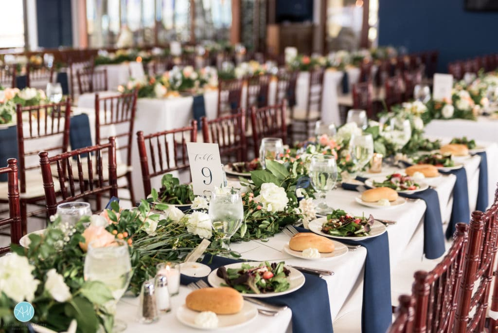 wedding tables set with flowers and white blue linens