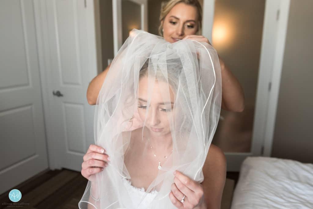 bride getting ready under veil