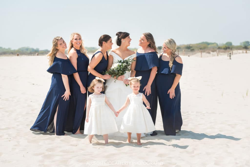 bride and bridesmaids on the beach in Cape May