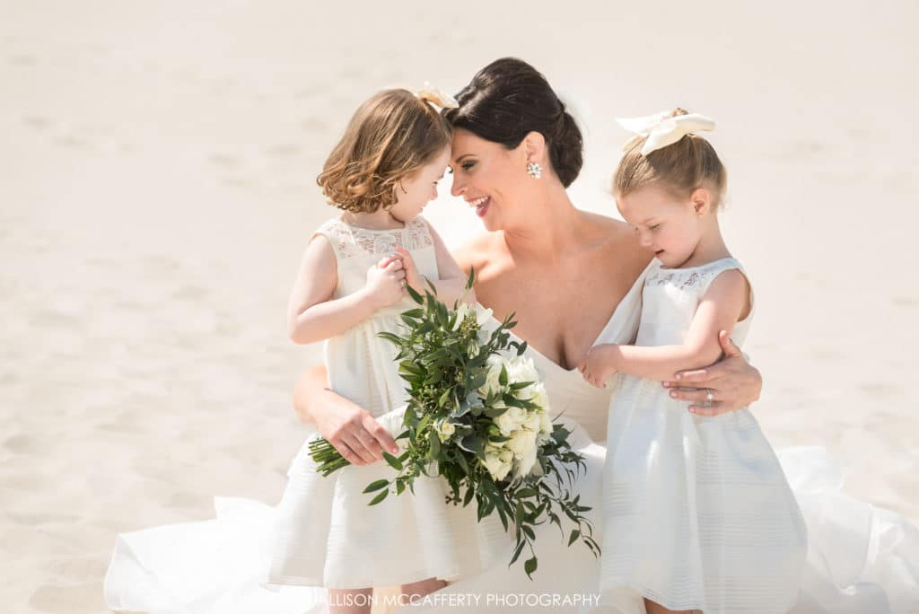 Flower girls and bride on beach in Cape May