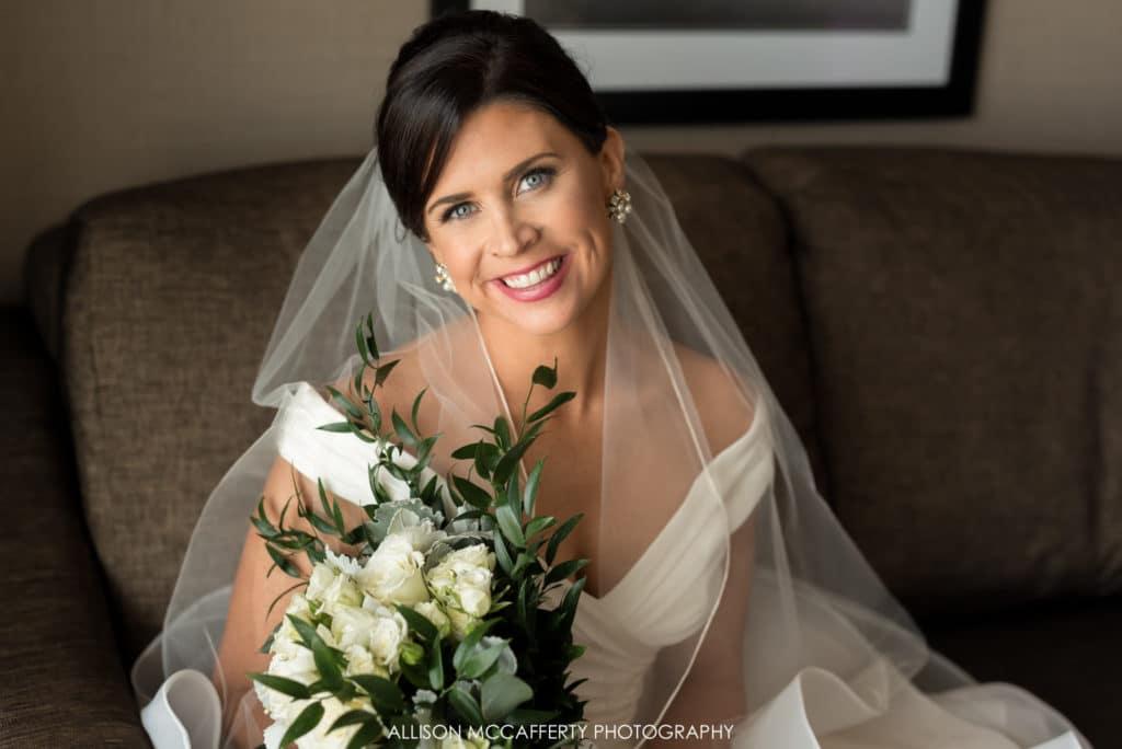 Blue eyed bride sitting for a portrait