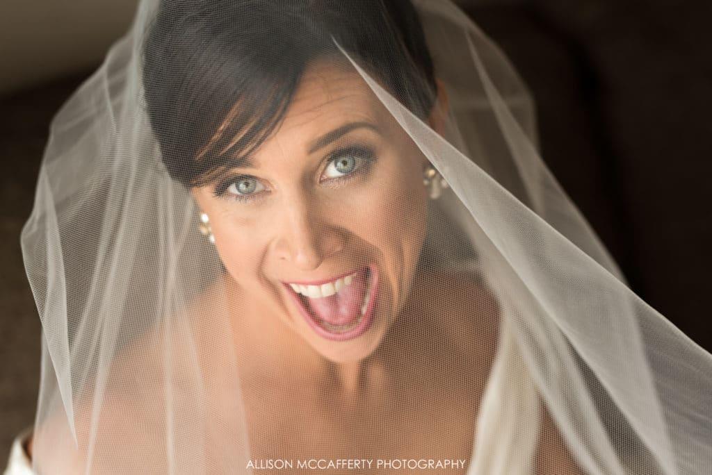 Excited bride under veil