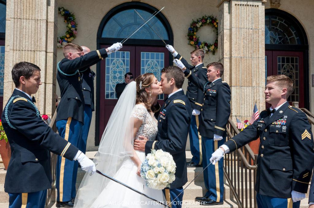 Army swords outside wedding