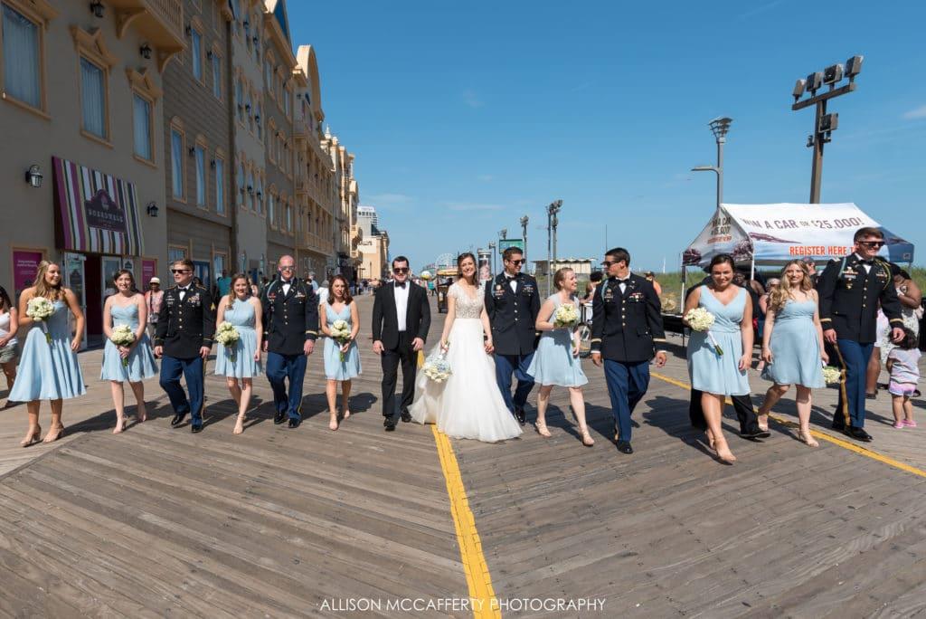 Bridal party walking down the boardwalk in Atlantic City