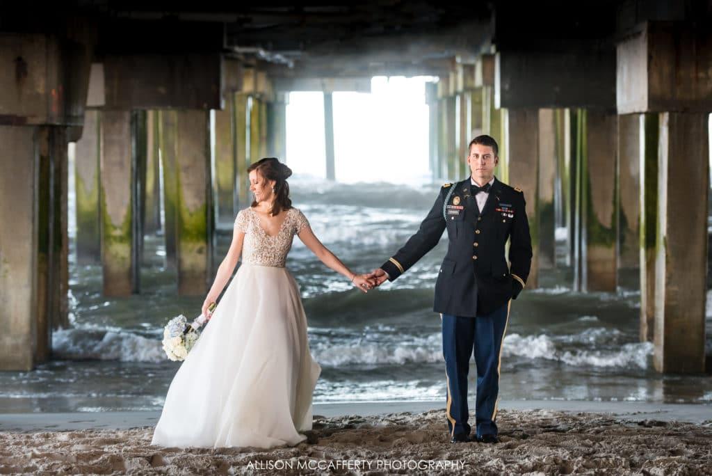 Bride and groom under the pier in Atlantic City