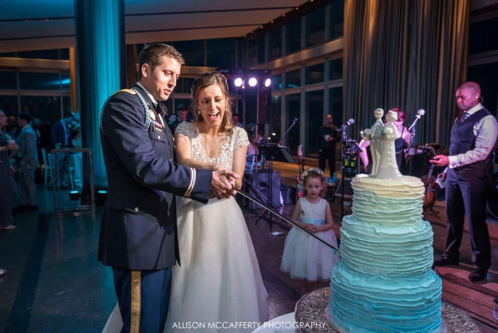 cutting wedding cake with saber
