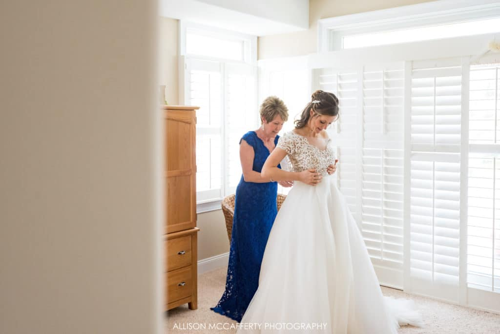 Mother of the bride dressing her daughter