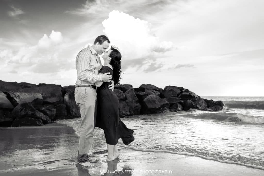 black and white beach engagement photo