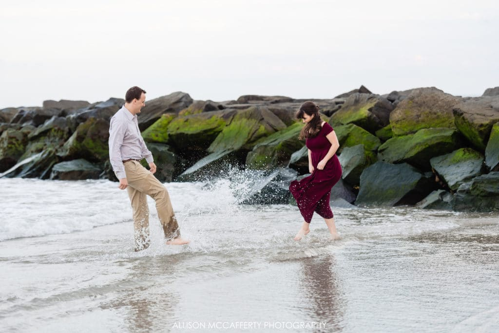 couple splashing in the ocean
