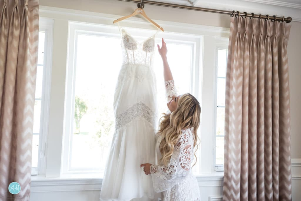 Wedding gown hanging in the Atlantic City Country Club bridal suite