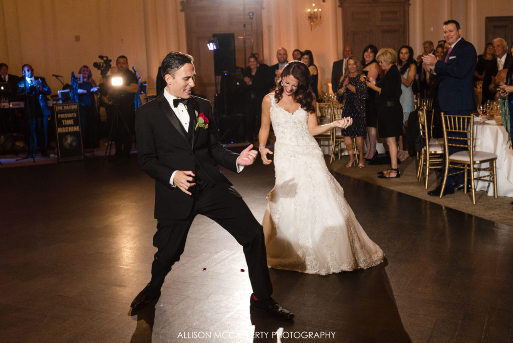 Bride and groom air guitar at their wedding reception at the Park Chateau
