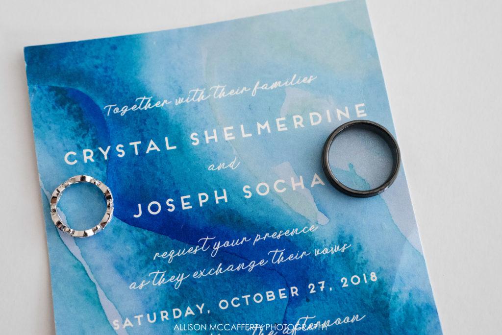 Blue swirl wedding invitation