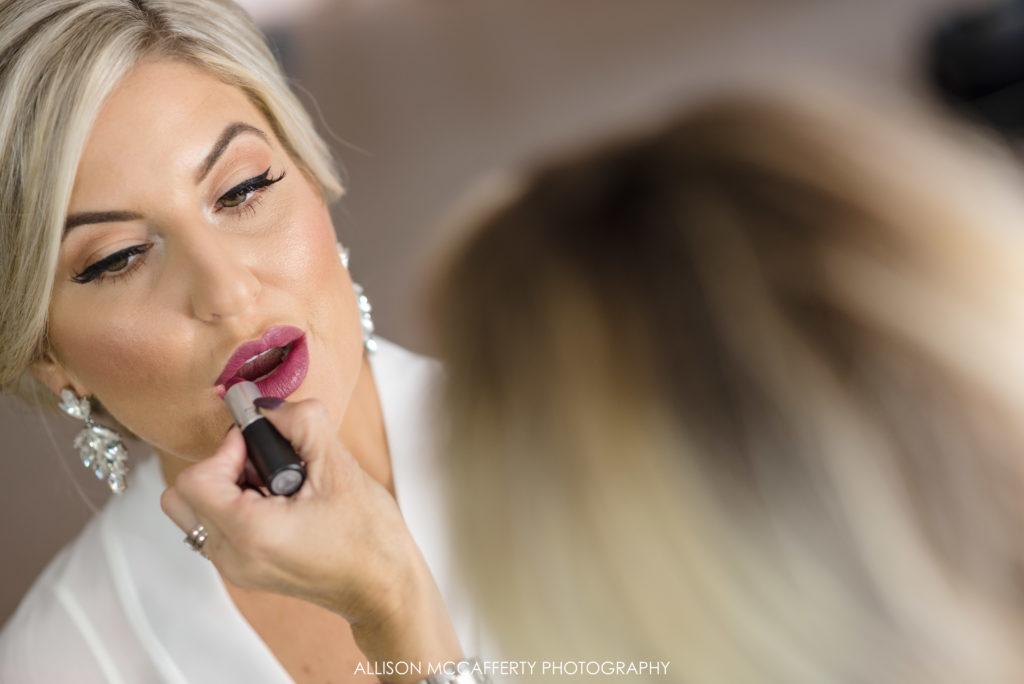 blonde bride getting makeup done