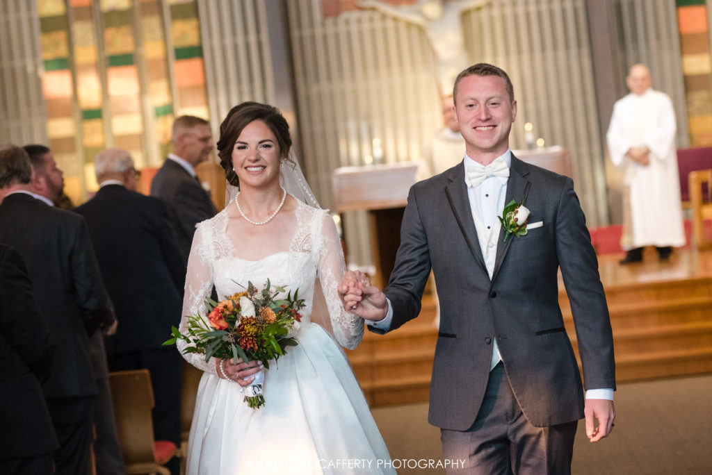 Bride and groom exiting church after wedding ceremony