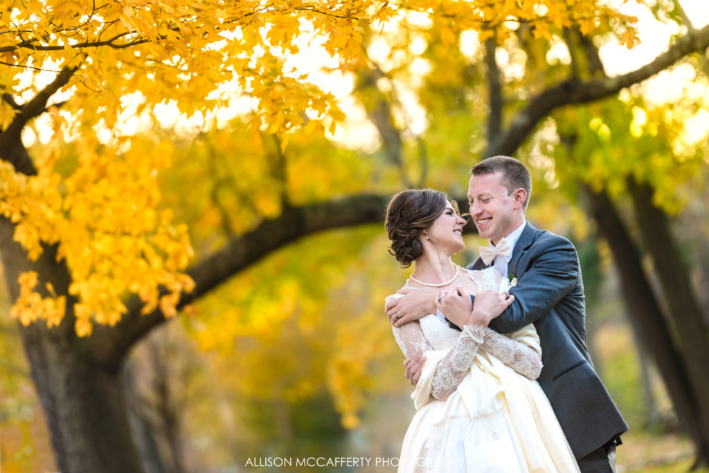 Bride and groom under yellow tree in Collingwood NJ