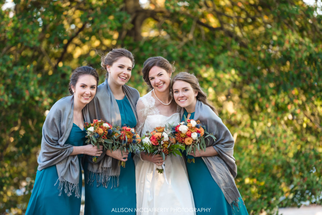 Bride and her maids in teal dresses