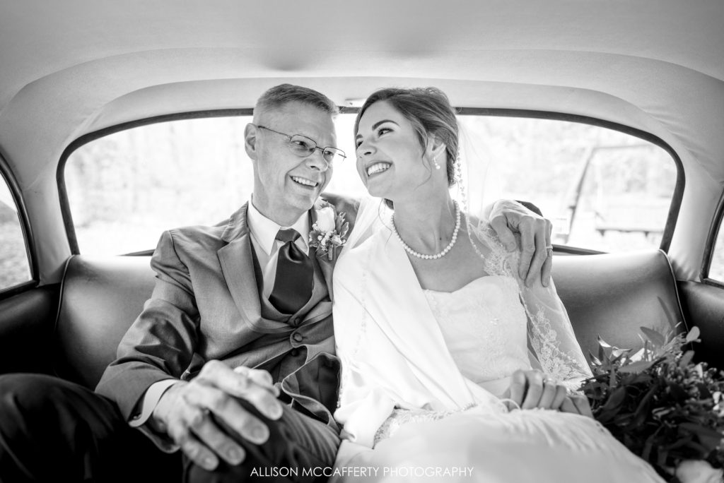 Bride and her Dad in his old taxi before going to wedding ceremony