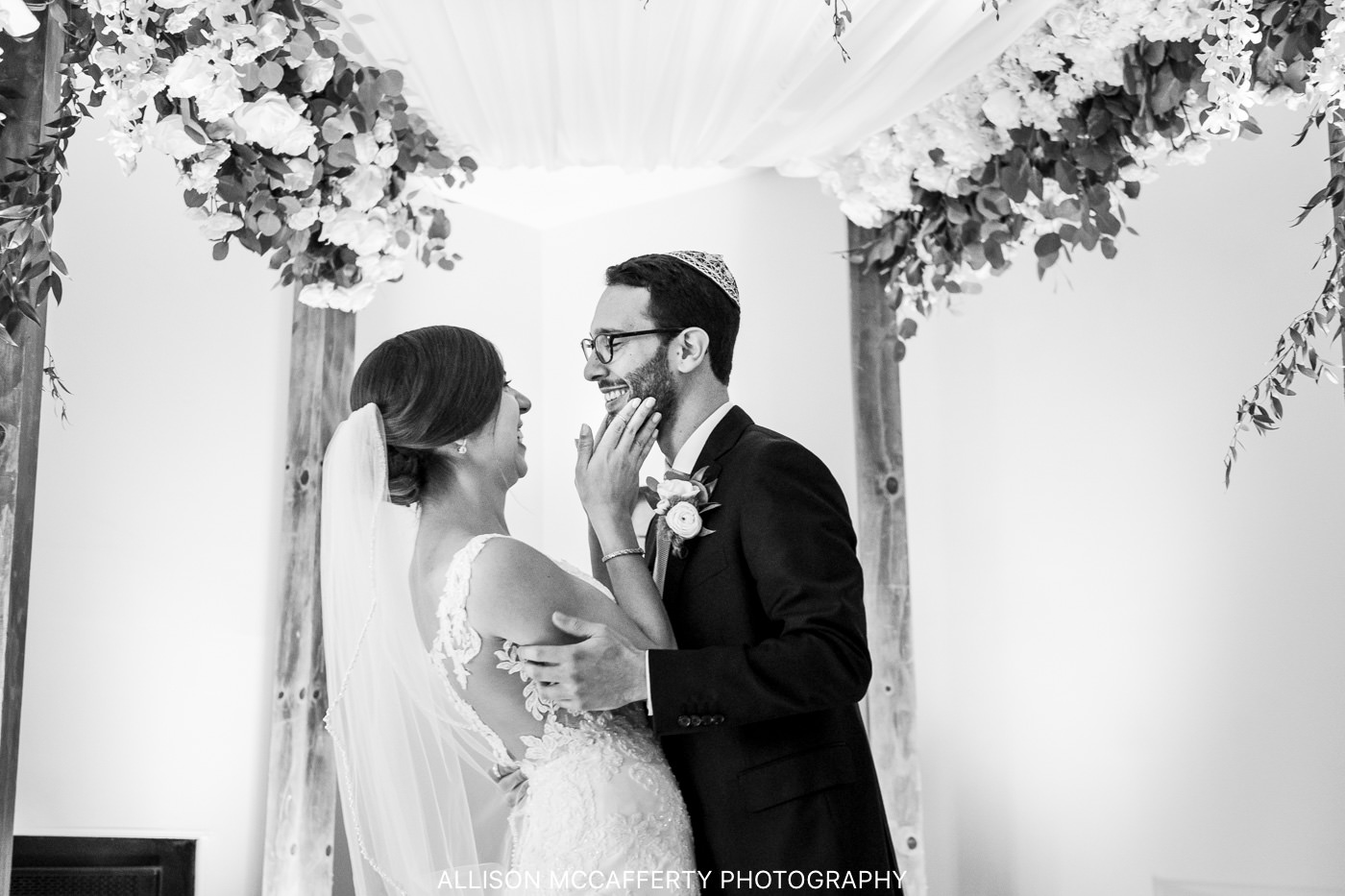 Couple under huppah black and white photo